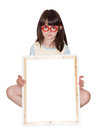 Girl with banner in red glasses holding white frame isolated Royalty Free Stock Image
