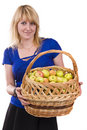 Girl with a basket of apples. Royalty Free Stock Photography