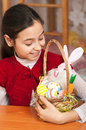 Girl with a basket of Easter eggs Stock Images