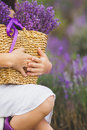Girl with a basket of flowers lilac lavender Royalty Free Stock Photo