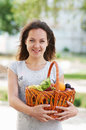 The girl with basket of food Stock Photo