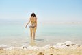Girl bathe in dead sea young woman israel Stock Photography