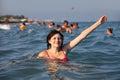 Girl bathes in the sea