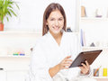 Girl in bathrobe at home with touch pad Royalty Free Stock Image