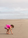 Girl beach combing in pink Stock Photos