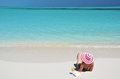 Girl on the beach of exuma bahamas with a glass orange juice Stock Photos