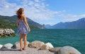 Girl at the beach of garda lake Royalty Free Stock Photo