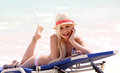 Girl on the beach. glamorous blonde on vacation. happy beautiful young woman with summer hat Royalty Free Stock Photo