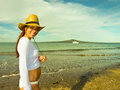 Girl on the beach a new zealand enjoys sun Royalty Free Stock Image