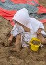 Girl. Beach. Toys. Summer. Towel. Sand. Cute Royalty Free Stock Photo