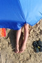 Girl on the beach under a beach umbrella Royalty Free Stock Photo