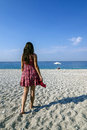 Girl on a beach walking towards relax place Royalty Free Stock Photo