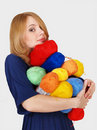 Girl bears many color hanks of a yarn Royalty Free Stock Image