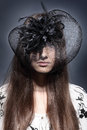 Girl in a beautiful black hat with feathers Royalty Free Stock Photos