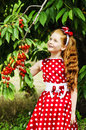 Girl in a beautiful dress in garden cherry Stock Photography