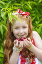 Girl in a beautiful dress in garden cherry Stock Photo