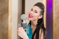 Girl with beautiful eyes in room with microphone and red lips recording studio Stock Photo