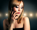Girl beautiful make up dark background Royalty Free Stock Image