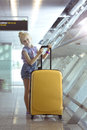 Girl and beautiful yellow suitcase