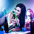 Girl with beer bottle at drug fueled house party Stock Images