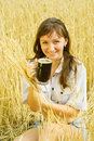 Girl  with beer at cereals field Royalty Free Stock Photo
