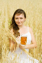 Girl  with beer at cereals field Royalty Free Stock Photography