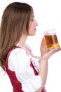 Girl with beer young sexy in national dress a glass of hand isolated on white background Royalty Free Stock Image