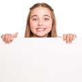 Girl behind a white board cute little Royalty Free Stock Photography