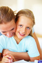 Girl being assisted by her mom for her homework Royalty Free Stock Images