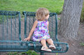 Girl on a bench three year old waits alone Stock Photo