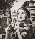 Girl in beret and scarf holding a vintage camera Royalty Free Stock Photo
