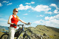 The girl with a bicycle against mountains Royalty Free Stock Photos