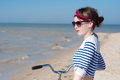 The girl with bicycle beautiful on walk at sea against blue sky Stock Photography