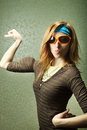 Girl with big biceps funny sports in sunglasses fake Stock Photos