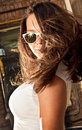 Girl with big breast in sunglasses looking over shoulder Royalty Free Stock Image