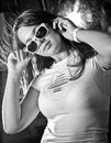 Girl with big breast in sunglasses looking over shoulder Royalty Free Stock Images
