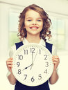 Girl with big clock picture of beautiful Stock Image