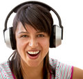 Girl with big earphones Stock Image