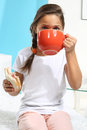 Girl with a big red cup Royalty Free Stock Photo