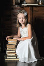 Girl with a big stack of books photo in vintage style Royalty Free Stock Images