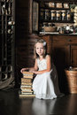 Girl with a big stack of books photo in vintage style Royalty Free Stock Photography
