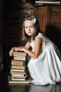 Girl with a big stack of books photo in vintage style Royalty Free Stock Image