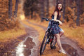 Girl on bike at forest Royalty Free Stock Photo