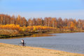 Girl with bike on lakeside a riding a in beautiful autumn day Royalty Free Stock Photography