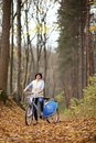 The girl on a bike from the rental in the forest. Royalty Free Stock Photo