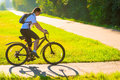 Girl on bike rides on the bike path in park Royalty Free Stock Photo