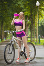 Child little girl riding bike in park