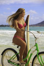 Girl with bike and surfboard Royalty Free Stock Photo