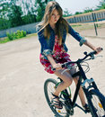 Girl on bike whimsical with flowing hair riding a Royalty Free Stock Images
