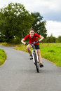 Girl biking on cycle lane Stock Images